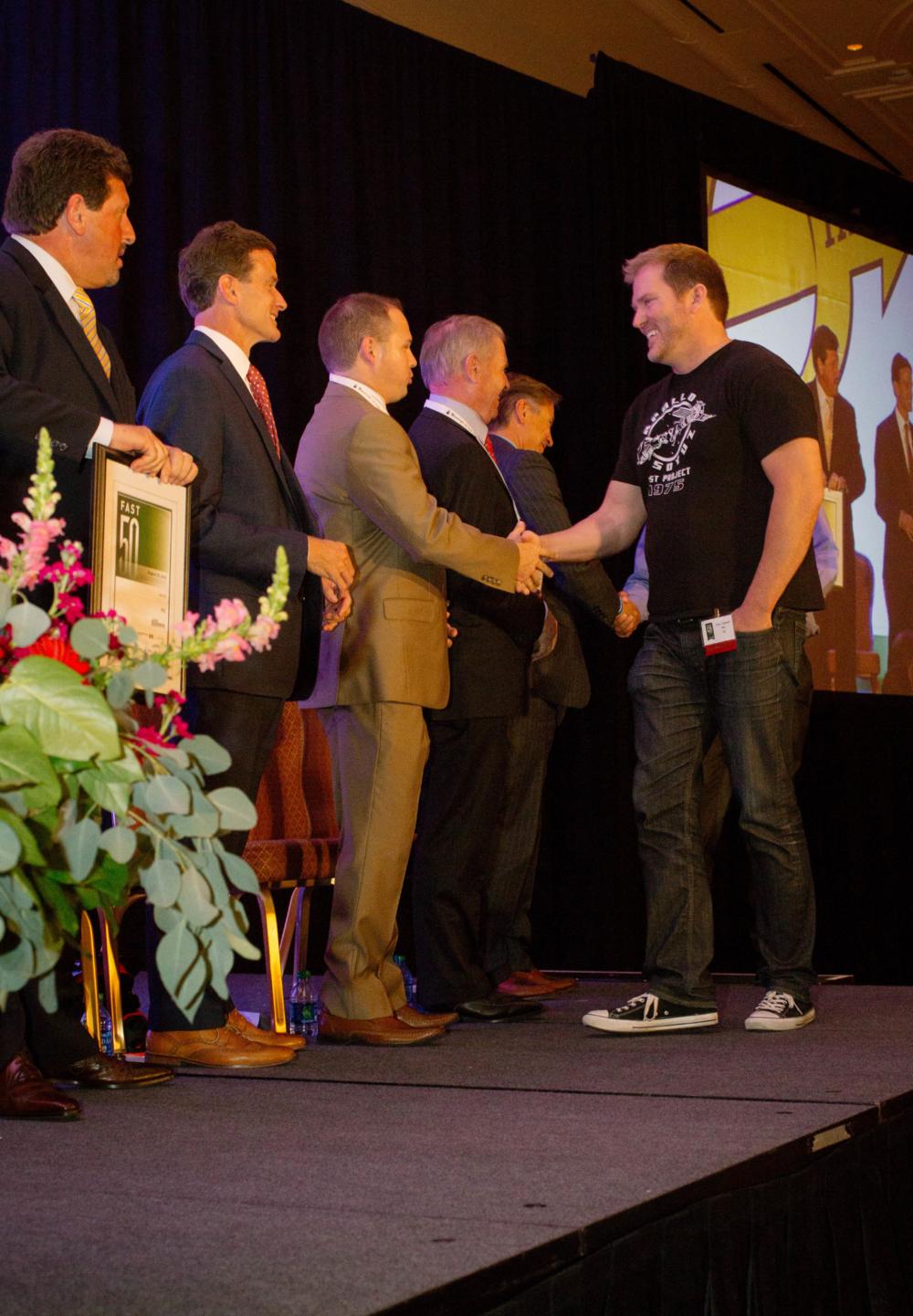Ryan Caldwell accepting the Fast 50 award.